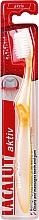 Parfumuri și produse cosmetice Periuță de dinți moale, galbenă - Lacalut Aktiv