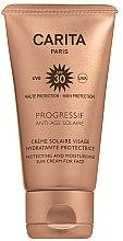Parfumuri și produse cosmetice Cremă de protecție solară pentru față SPF 30 - Carita Progressif Anti-Age Solaire Protecting And Moisturising Sun Cream For Face