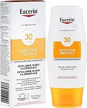 Parfumuri și produse cosmetice Loțiune de corp SPF30 - Eucerin Sun Protection Lotion Extra Light SPF30