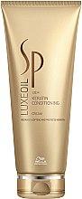 Parfumuri și produse cosmetice Cremă-balsam regenerant pentru păr - Wella SP Luxe Oil Keratin Conditioning Cream
