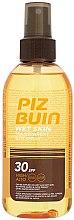 Parfumuri și produse cosmetice Spray de corp cu protecție solară - Piz Buin Wet Skin Transparent Sun Spray SPF30