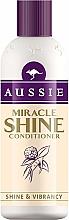 Parfumuri și produse cosmetice Balsam pentru părul obosit și deteriorat - Aussie Miracle Shine Conditioner