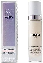Parfumuri și produse cosmetice Loțiune de zi pentru față - Carita Progressif Anti-Age Solaire Le Fluide Urbain SPF15