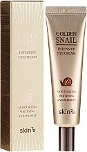 Parfumuri și produse cosmetice Cremă pentru conturul ochilor cu secreție de melc și aur - Skin79 Golden Snail Intensive Eye