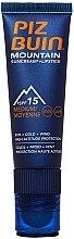 Parfumuri și produse cosmetice Cremă de protecție pentru față și buze - Piz Buin Mountain Sun Cream Plus Lipstick SPF15