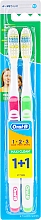 Parfumuri și produse cosmetice Set periuțe de dinți, medium (roz + verde) - Oral-B 1 2 3 Maxi Clean 40 Medium 1 + 1