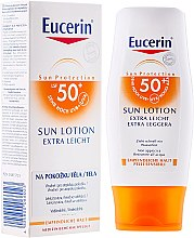 Parfumuri și produse cosmetice Loțiune pentru corp Extra Light SPF50 - Eucerin Sun Protection Lotion Extra Light SPF50