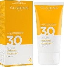 Parfumuri și produse cosmetice Cremă cu protecție solară pentru corp - Clarins Solaire Corps Hydratante Cream SPF 30